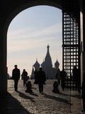 Silhouettes of people on the background of the gate entrance to the red square Moscow historical landmark symbol royalty free stock photo
