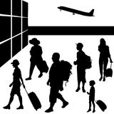 Silhouettes of people with baggage. Royalty Free Stock Photography