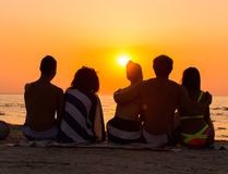 Silhouettes of a people on a beach Stock Images