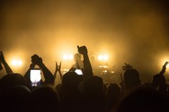 Silhouettes of concert stock photos