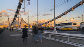 Silhouettes of people and cars on the steel bridge. Moscow Stock Photography