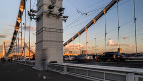 Silhouettes of people and cars on the steel bridge. Moscow Royalty Free Stock Photography