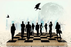 Silhouettes of people on the chess-board Royalty Free Stock Photography
