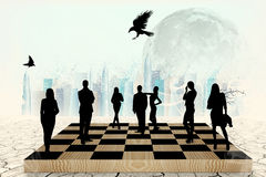 Silhouettes of people on the chess-board Stock Photos