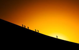 Silhouettes of people climbing Royalty Free Stock Image