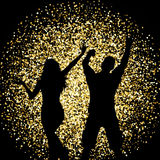 Silhouettes of people dancing on gold glitter background Stock Image