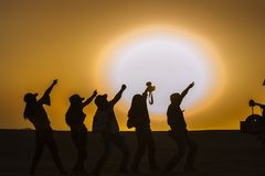 Silhouettes of people in desert Stock Photography