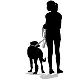 Silhouettes of people and dogs. Stock Image