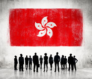 Silhouettes of People and a Flag of Hong Kong Royalty Free Stock Photo