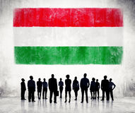 Silhouettes of People and a Flag of Hungary Royalty Free Stock Images