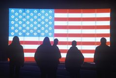Silhouettes of People in front of an American electric Flag, Winter Olympics, Salt Lake City, Utah Stock Photo
