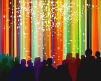 Spectators in front of a bright colorful curtain and confetti Royalty Free Stock Photography