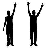 Silhouettes of people with hands in the air Royalty Free Stock Image