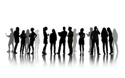 Silhouettes of People Having Group Discussion Stock Photo