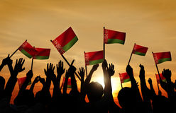 Silhouettes of People Holding Flag of Belarus Stock Image