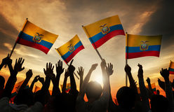 Silhouettes of People Holding Flag of Ecuador Stock Image