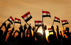 Silhouettes of People Holding the Flag of Egypt Stock Image