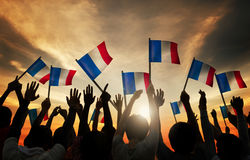 Silhouettes of People Holding the Flag of France Stock Photography