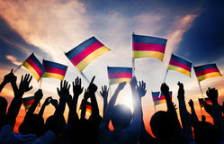 Silhouettes of People Holding Flag of Germany Royalty Free Stock Image