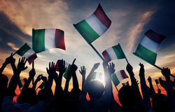 Silhouettes of People Holding Flag of Italy Royalty Free Stock Photography