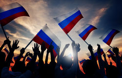 Silhouettes of People Holding Flag of Russia Royalty Free Stock Image