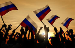 Silhouettes of People Holding Flag of Russia Stock Photography