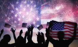 Silhouettes of people holding the Flag of the USA. Royalty Free Stock Photo