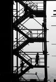 Silhouettes of people at the industrial project stock photos