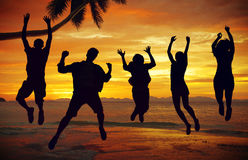 Silhouettes of People Jumping by the Sea.  royalty free stock photos