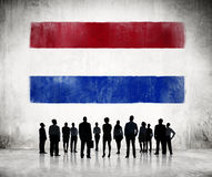 Silhouettes People Looking at the Flag of Netherlands Royalty Free Stock Images
