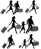Silhouettes of people with luggage Royalty Free Stock Photos