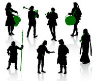 Silhouettes of people in medieval costumes. stock illustration