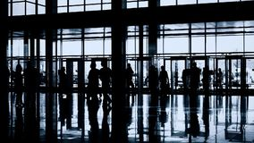 Silhouettes of people in modern hall stock video footage