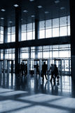 Silhouettes of people in modern hall Stock Photo
