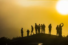 Silhouettes of people on the mountain stock photo