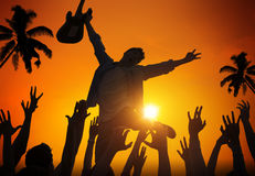 Silhouettes of People in Music Festival by the Beach Royalty Free Stock Photo
