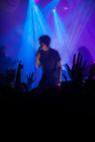 Silhouettes of people and musicians in big concert stage Stock Photos