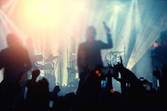 Silhouettes of people and musicians in big concert stage Royalty Free Stock Images