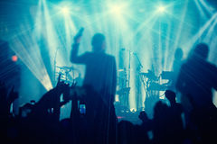 Silhouettes of people and musicians in big concert stage Royalty Free Stock Photo
