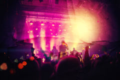 Silhouettes of people and musicians in big concert stage Stock Photography