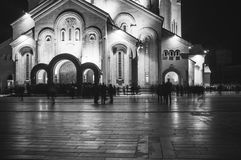 Silhouettes of people near the Trinity Cathedral in Tbilisi on Easter night. royalty free stock photo
