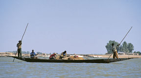 Silhouettes of people on Niger river Stock Photography