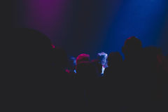 Silhouettes of people in night club. Silhouettes of people in a night club Stock Images
