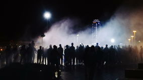 Silhouettes of people in the night a crowd stock video footage