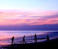 Silhouettes of people playing football on the beach. When the sun sets in Thailand Stock Photography