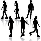 Silhouettes of people rollerskating. Vector Royalty Free Stock Photography