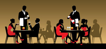 Silhouettes of people sitting at tables in a restaurant or night Stock Images