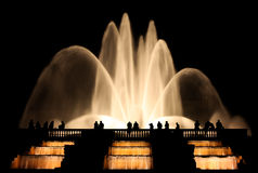 Silhouettes of people spending his time at night at the fountain Stock Photography