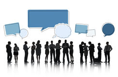 Silhouettes of People Talking and Speech Bubbles Stock Images