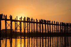 Silhouettes of people on U Bein bridge over the Taungthaman Lake at sunset, in Amarapura, Mandalay Myanmar Royalty Free Stock Photos